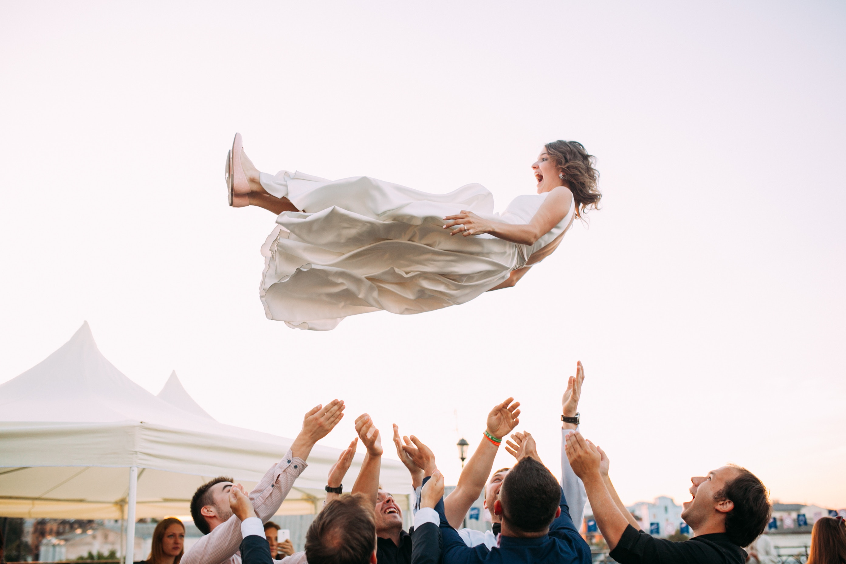 New wife thrown in the air as part of the wedding celebration. Brooklyn Dance Lessons bridesmaids package.