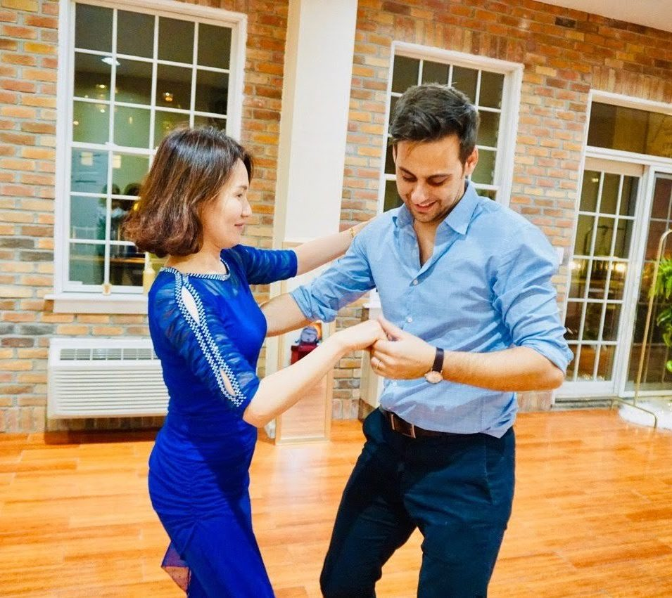 Man and woman dancing at Brooklyn Dance Lessons. Alessandro Spreafico co-founder of BDL social dancing.
