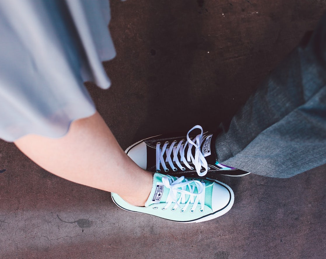 Couple wearing converse sneakers, jeans, and a blue dress. Brooklyn Dance Lessons wedding package.