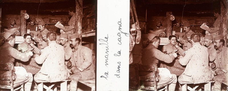 Birthday Post #7: French soldiers sit around a table in a dugout playing cards