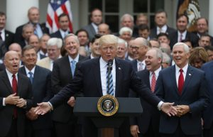"Donald Trump and House Republicans celebrate passage of the American ""WealthCare"" Act, a bill that strips 24 million Americans of health coverage and gives a tax cut to the wealthy."