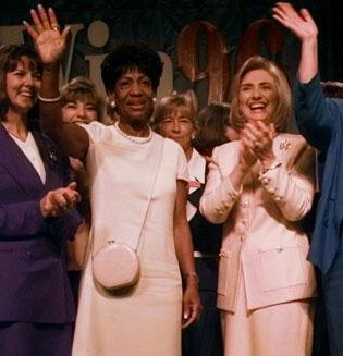 Auntie Maxine, is that you?! Then First Lady Hillary Clinton pictured in dual pink with Congresswoman Maxine Waters (D-CA).
