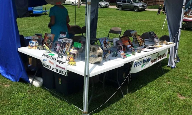 Church booth features T-Rex skull model at county fairs