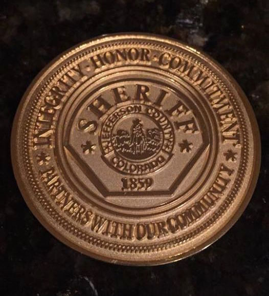 Dale received a coin from police.