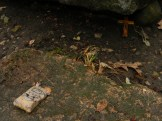 Trinkets left on a grave - Bachelor's Grove Cemetery