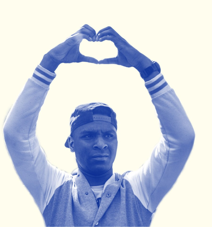 Young man of color making heart sign with hands