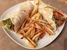 Pulled pork wraps with avocados, sprouts and oven fries