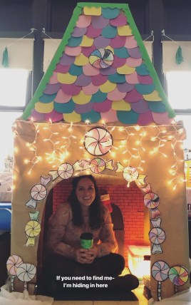 Meg inside of gingerbread house