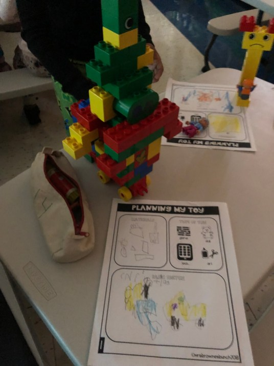 Students use large building blocks to create their own toys