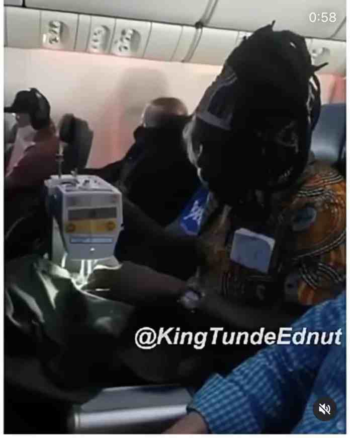 This man means business! Man spotted sewing on a plane (Video)