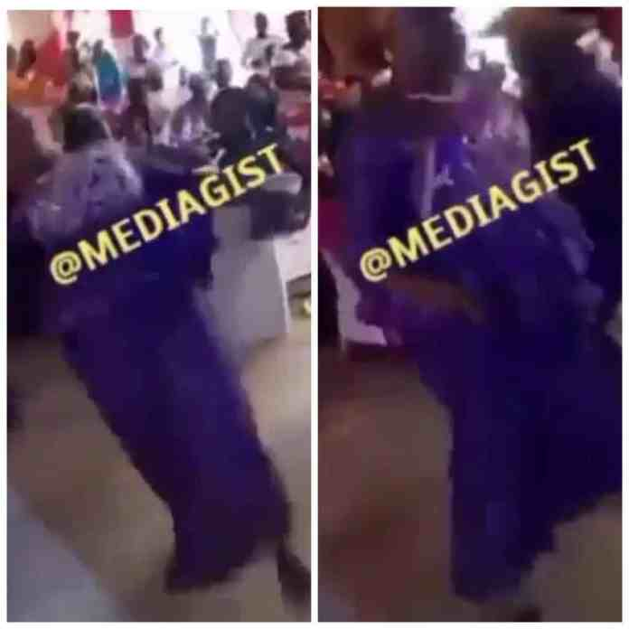 Elderly woman falls flat on the ground as she tried to do 'gbese' dance move at a wedding reception (Video)