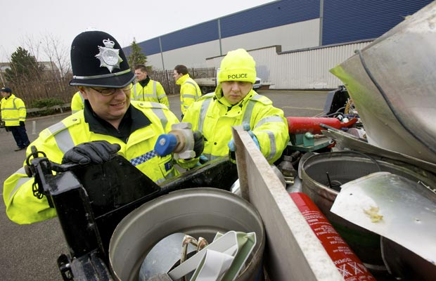 police-officers-check-a-van-891363405