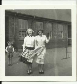 teachers, Miss Ellis and colleague. Image courtesy Eleanor Holland & David Evans.