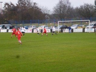 An early attack by the home side in red. Image kindly supplied by David Evans.