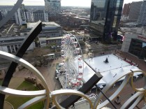 High above the ferris wheel, and nearly as high as the Hyatt.