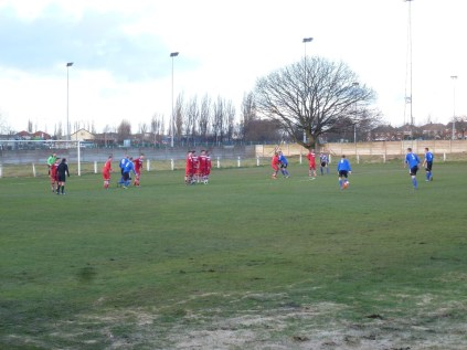 Barnsley about to take a free kick, effectively blocked by Walsall Wood's goalkeeper.
