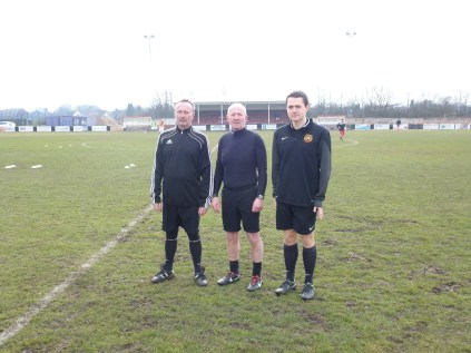 Match referee Mr Gary Walker and his two assistants, Stuart Winton and Mark Winston kindly posing for the photo before the match got under way on a cold and clear winter's afternoon.