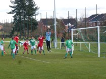 Brocton's goalkeeper rising to catch the ball from a fine corner kick.