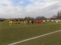 The line-up and customary handshake before the kick off, with Basford in yellow tops