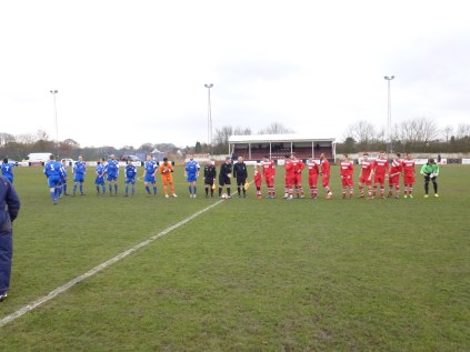 A brisk cross wind, and the players line-up before shaking hands, with Mollie leading the WWFC team.