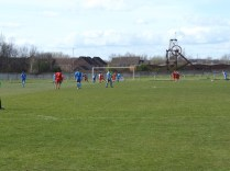 Walsall Wood prepare to defend a Rocester free kick.
