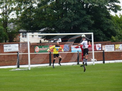 A fine header, well saved by Wood's keeper