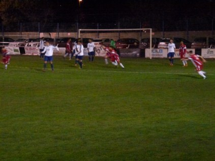 Wood show dejected Coleshill defenders a clean pair of heels as they score their second goal