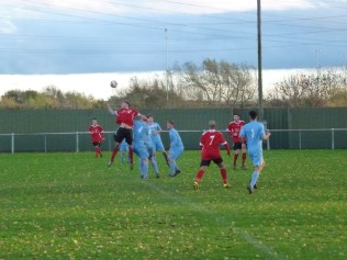 A long kick out by Dunkirk goalkeeper finds its mark