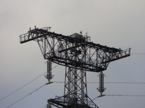 The two pylons either side of the bridge are of a curious design I can't work out. Why the added platforms at the top?