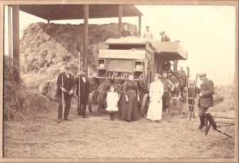 Threshing at Mile Oak Farm 1916-1918 The gent on the extreme right is my great grand father, the lady in white my great aunt Ethel also an accomplished horse woman winning at the White City Show Jumping, the lady in black my great grand mother and the little girl in white my aunty Peggy. The rest I'm afraid are unknown but obviously formed the threshing party on that day.
