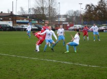 A long, high kick by the Wood's keeper being closely monitored by Westfields defenders