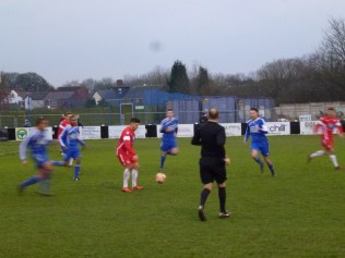 Four Dunkirk players close in to challenge Joey Butlin.
