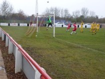 Fine clearance leap by Shepshed goalkeeper. Super soccer. Delightful to spectate.