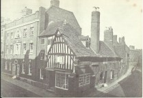 Victoria Street c 1870. At the junction with John Street. The timbered building and the elegant brick house still stand, though the latter is changed almost out of recognition.