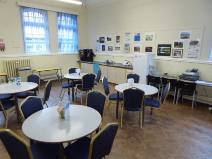 The adjoining refreshment room; one of the suite of rooms .
