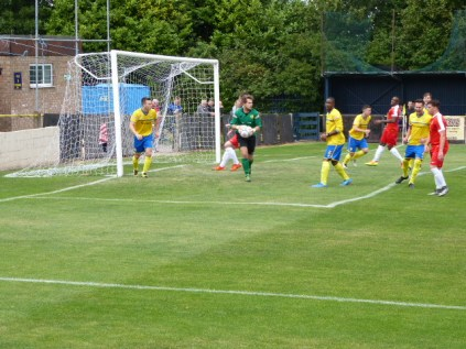 A first half attack by the Wood and Tividales keeper responds to the challenge.