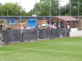 """Well-hydrated spectators, seen here before the kick-off, being entertained by the strains of """"its raining men"""" from over the Tannoy. Love Tividale and their welcome."""