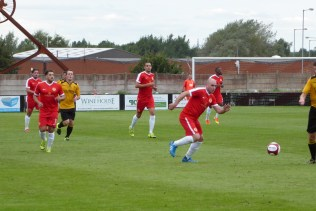 Determined Wood first to break away here as Alvechurch react.