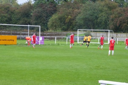 Ricochet shot goal ; elation to Rocester and fleeting dismay to the Wood