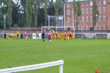 In the blur of a cloudburst the Wood score their first goal, late in the second half