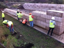 The Waterway Recovery Group placing reinforcement ready for the concrete on the canal wall over the Cranebrook culvert at Summerhill
