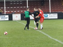 Captains shake hands on the lush rich grass pitch and forgiving surface.