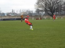 One of many long kicks to launch attacking moves, a move employed throughout the match by both sides.