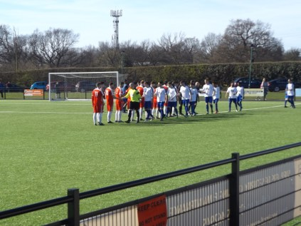 Coleshill in white shake hands with WWFC before the start of the match …and no minute's silence.