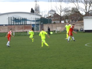 Blurred example of poor arm control by Highgate players closely shadowing the Wood's front line players