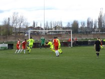 Wood attacking move and Highgate defender rising to the challenge .