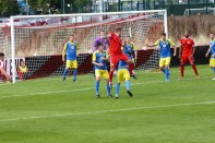 An early near miss by the Wood brings close defending by Tividale