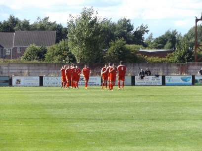 The Wood celebrate scoring their third goal . The Wood are on song!