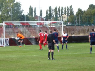 The Wood's Lewis Taylor Boyce tests Littleton's goalkeeper