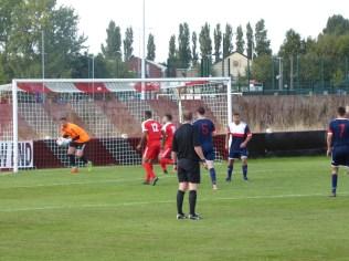 The Wood's Lewis Taylor Boyce tests Littleton's goalkeeper
